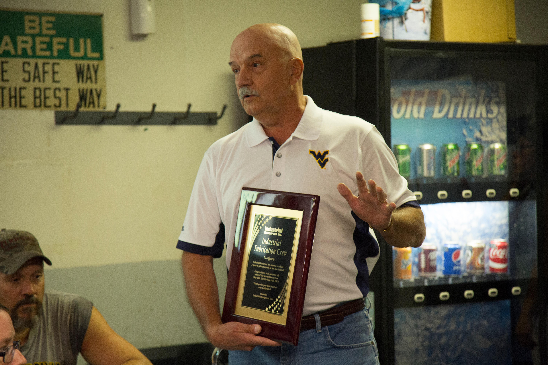 Phil Burnside, President, Holding Achievement Award